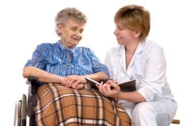 nurse reading to elderly