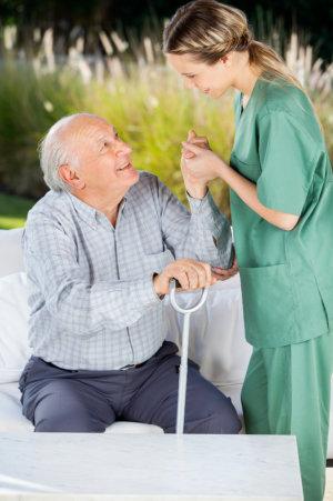 nurse helping an elderly