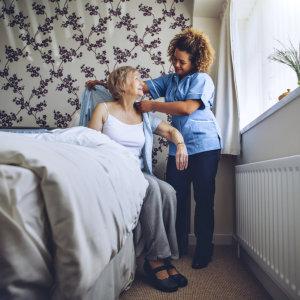 nurse dressing elderly