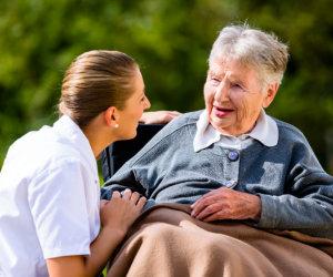 nurse talking with an elderly